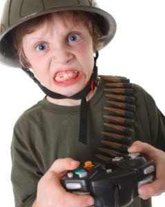 boy with helmet and video game controller