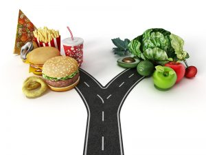 Road with a choice between fast food and healthy food.